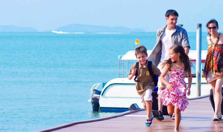 A family of 4 arriving at the resort with their luggages.